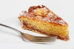 Bakewell tart and fork Stock Image
