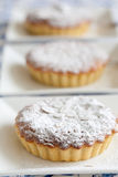 Bakewell tarts. Freshly baked bakewell tarts in a row Royalty Free Stock Photography
