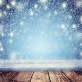 bakgrund är kan jul, designillustration somnatten använde ditt En snöstorm och en tom tabell i th Royaltyfri Foto