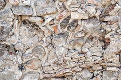 Bakgrund av antikviteten stenar väggen Gammalt lägga av stenar arkivfoton