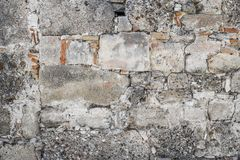 Bakgrund av antikviteten stenar väggen Gammalt lägga av stenar arkivfoto