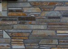 Bakgrund av bearbetade stenar med olika färger av varmt och Arkivbilder