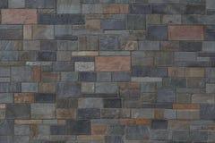 Bakgrund av bearbetade stenar med olika färger av varmt och Royaltyfri Bild