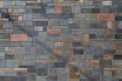 Bakgrund av bearbetade stenar med olika färger av varmt och Royaltyfri Foto