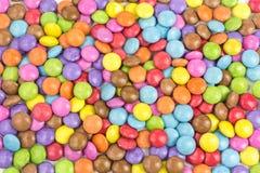 Bakgrund av bestrukna godisar för socker Royaltyfria Bilder