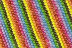Bakgrund av bestrukna godisar för socker Royaltyfri Fotografi