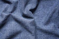 Bakgrund av blåa Gray Crumpled Jeans Cloth Arkivbilder