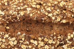 Bakgrund av brunt bröd för korn. Royaltyfri Fotografi