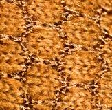 Bakgrund av brunt stuckit tyg Arkivfoto