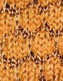 Bakgrund av brunt stuckit tyg Royaltyfri Bild