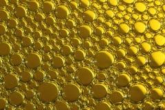 Bakgrund av bubblor i guling Fotografering för Bildbyråer