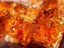 Bakgrund av cola Arkivbild