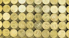 Bakgrund av de 10 rubel mynten Royaltyfri Bild
