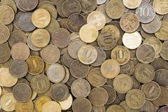 Bakgrund av de 10 rubel mynten Royaltyfria Foton