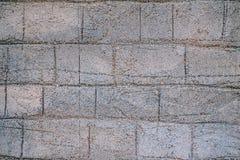 Bakgrund av den forntida tegelstenväggen Textur av den gamla amfiteaterstenen för design royaltyfria bilder