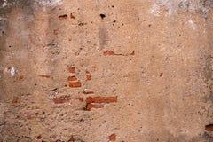 Bakgrund av den gamla tappningtegelstenväggen Arkivbild