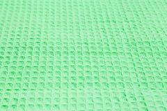 Bakgrund av den gröna dillandehandduken med den selektiva fokusen Arkivfoton