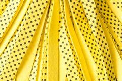 Bakgrund av den gula nya GOLVMOPPET close upp Begreppet av renhet Arkivbild