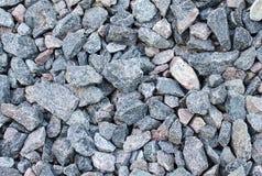 Bakgrund av den krossade granitstenen Arkivbilder