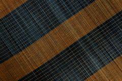 Bakgrund av den matta plattan för bambu, färgrik modell, bambutextur, mattt tomt utrymme av bambu Royaltyfri Bild
