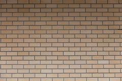 Bakgrund av den nya orange tegelstenväggen, abstrakt tappningdesign Arkivfoto