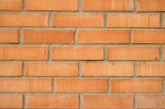 Bakgrund av den orange tegelstenväggen, tegelstenar med cement Fotografering för Bildbyråer