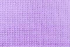 Bakgrund av den purpurfärgade bomullsdillandehandduken Fotografering för Bildbyråer