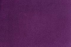 Bakgrund av den purpurfärgade eller violetta textilen med detaljerade modeller Arkivfoton