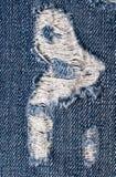 Bakgrund av den rev sönder jeansen Royaltyfri Foto