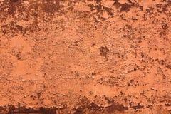 Bakgrund av den rostiga metallväggen Arkivbilder