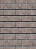 Bakgrund av den texturerade gråa tegelstenväggen Arkivfoton