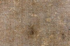Bakgrund av det gamla smutsiga tyget av lin i svart rök Arkivbilder