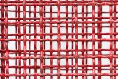 Bakgrund av det röda stålgallret Royaltyfri Bild
