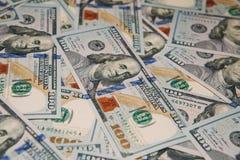 Bakgrund av 100 dollarräkningar Fotografering för Bildbyråer