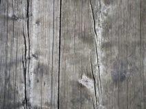 Bakgrund av ett grått träväggtexturslut upp Arkivfoton