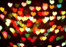 Bakgrund av färgrika hjärtor Arkivfoton