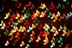 Bakgrund av färgrika musikanmärkningar Arkivbilder