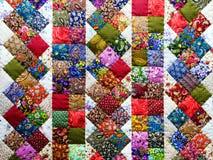 Bakgrund av färgrika patchworktyger Royaltyfri Bild