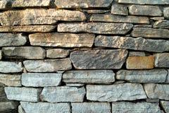 Bakgrund av fotoet för stenväggtextur Royaltyfria Bilder