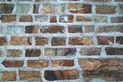 Bakgrund av fotoet för stenväggtextur Arkivfoton