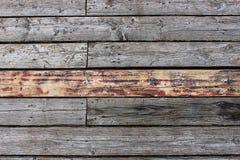 Bakgrund av gamla gråa träbräden Arkivbilder