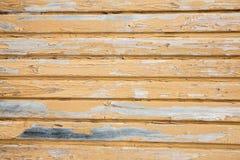 Bakgrund av gamla målade träbräden Arkivbilder