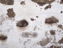 Bakgrund av gammal skadad textur för stenvägg Arkivbild