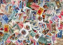 Bakgrund av gammala U.S.-portostämplar Royaltyfria Bilder