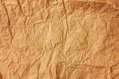 Bakgrund av gammalt skrynkligt kulört pergamentpapper arkivbild