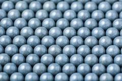 Bakgrund av gråa airsoftbollar av 6mm Arkivbilder