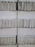 Bakgrund av gråa tegelstenar Arkivbilder