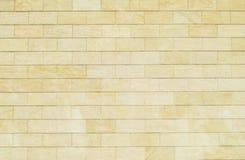 Bakgrund av gula tegelstenar Vägg av gula tegelstenar Texturen royaltyfri fotografi