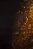 Bakgrund av guld- ljus med bokeheffekt Arkivbilder