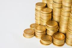 Bakgrund av guld- mynt Arkivfoton